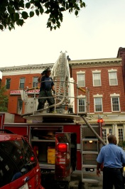 A Baltimore firefighter works on extinguishing a fire in Fells Point, Maryland June 12, 2012. (Photo/Kendra Yost)