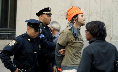 24. Police arrest a man involved in the OWS movement, Monday, Sept. 19, 2011. Protestors marched on Wall Street to protest taking big corporations out of politics. (Photo/Kendra Yost)