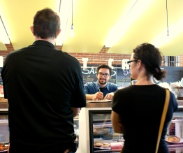 A man and woman contemplate what they will eat for lunch at the Phoenix Public Market, Friday, 2012. (Photo/Kendra Yost)